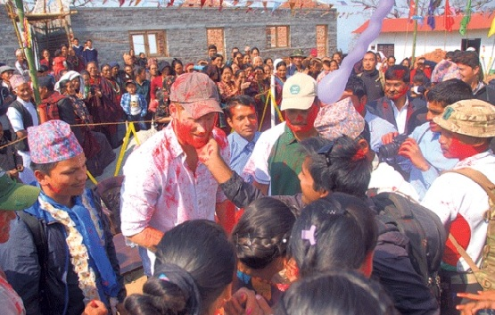 Britain's Prince Harry's Photos in Red during Holi in Nepal